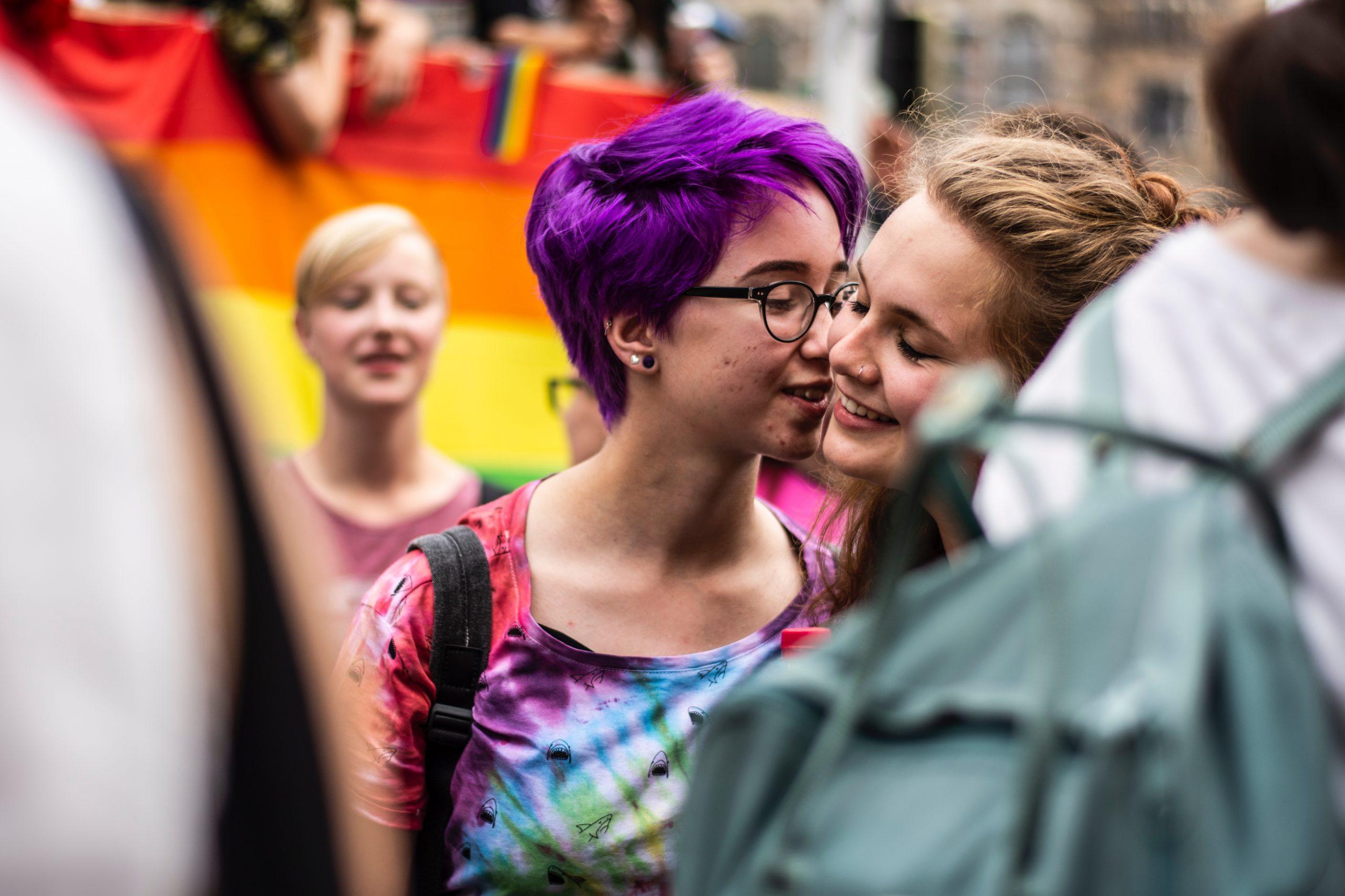 Two women kissing at a Pride parade