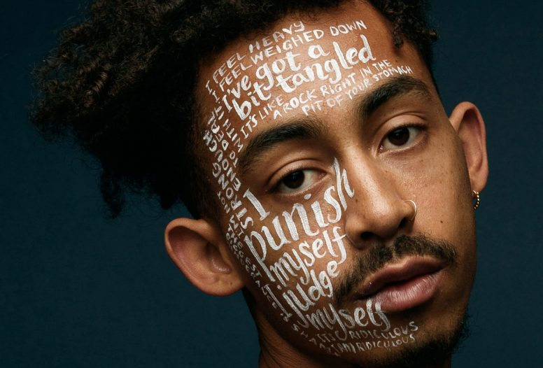 Man with writing all over his face