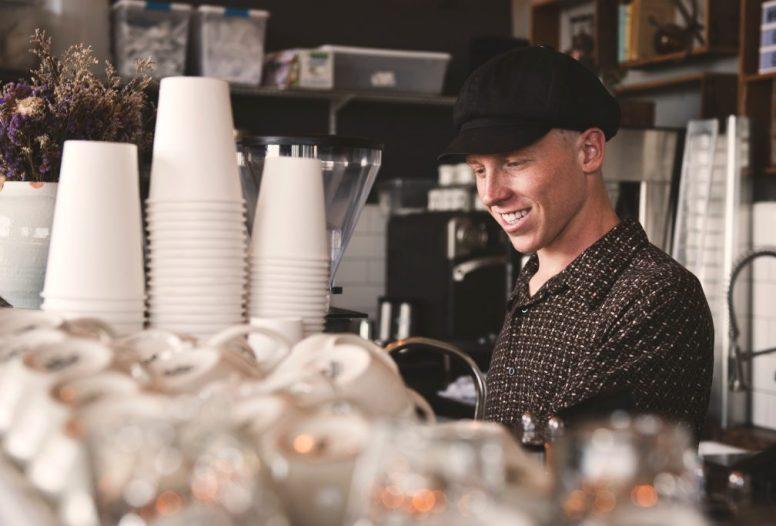 Barista man making a coffee