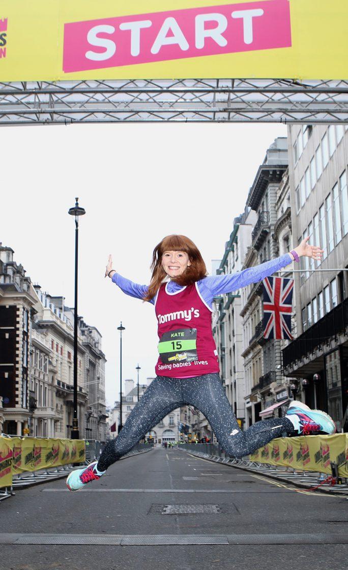 Girl jumping at the start of the London Landmarks Half Marathon