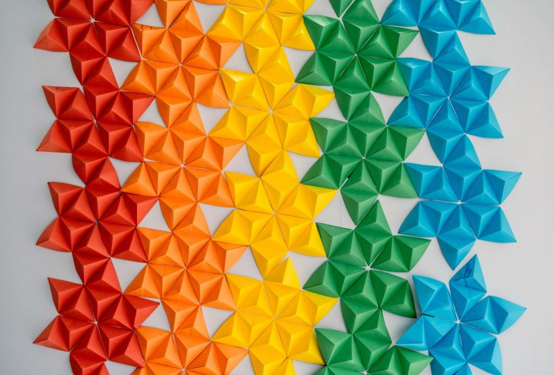 A repeating pattern from coloured folded paper