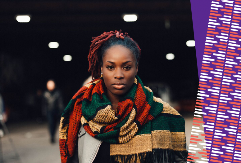 A powerful black women wearing a scarf staring at the camera