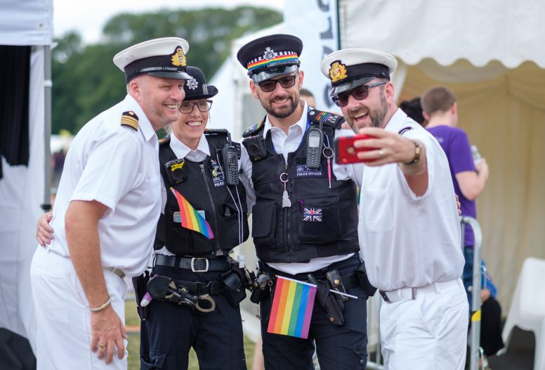 A group of people dressed in uniform at the Croydon Pridefest