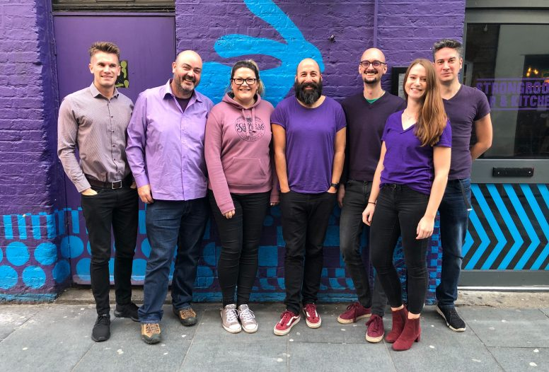 Fat Beehive team wearing purple to support Purple Tuesday