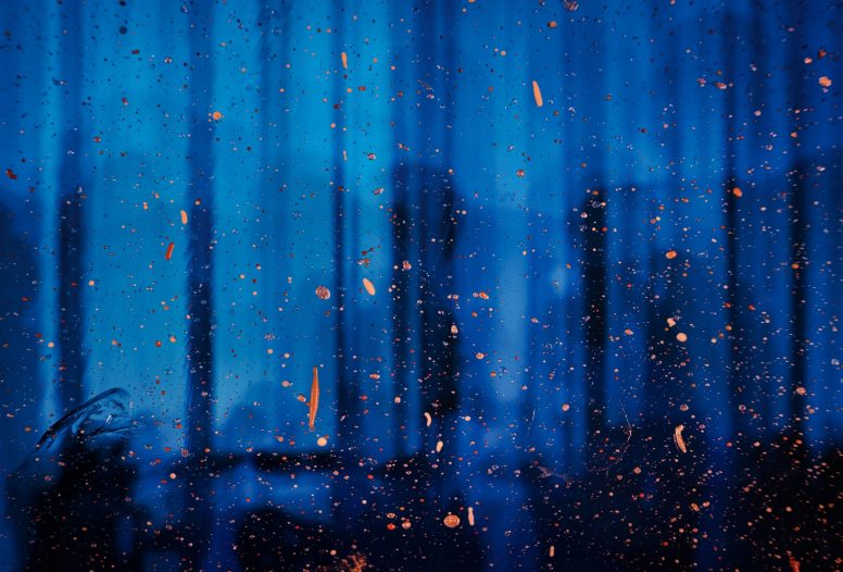 Abstract blue reflections with orange splatters