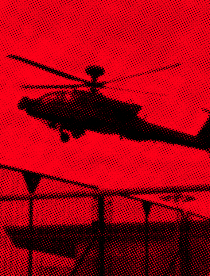 Red and black image of a military helicopter taking off with police in foreground