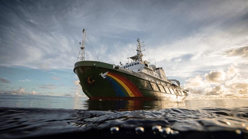 Greenpeace ship at sunset