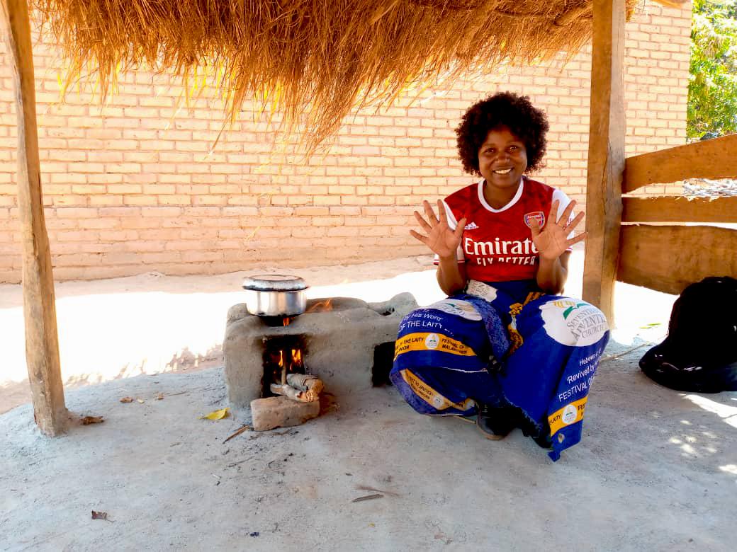 Dorah sat using her cookstove