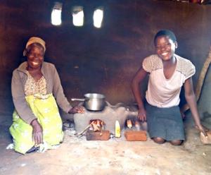 Joyce and Chimwemwe sat using their cookstove
